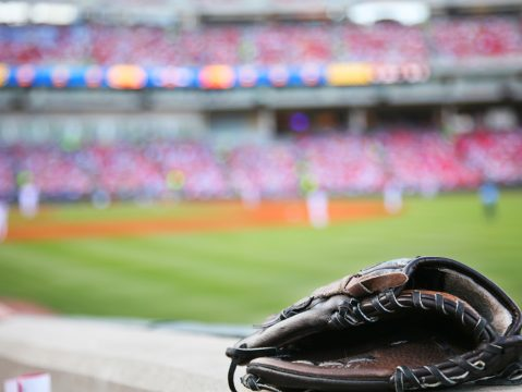 Marlins Park Stadium Miami - Baseball glove on the wall with a major league stadium in the background